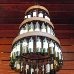 How cool is this wine bottle chandelier? It looks like something you'd find on a rustic wedding Pinterest board!